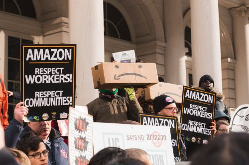 'Amazon does not have our best interests at heart': Protesters swarmed City Hall as New York's city council held its first hearing about Amazon's HQ2 deal