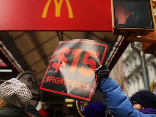 McDonald's raises minimum pay at corporate-owned stores across the US, as the battle for workers heats up