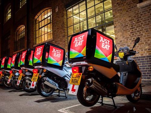 Shares in Just Eat jumped after Uber lost its licence to operate in London