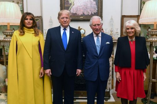 The Trumps hobnobbed with the British royal family during a NATO reception after a tense first day of the summit