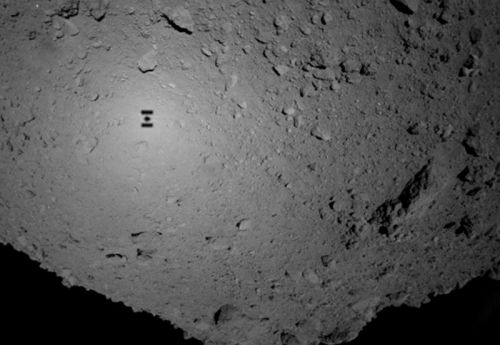 Japan's Hayabusa 2 mission lands on the surface of a distant asteroid