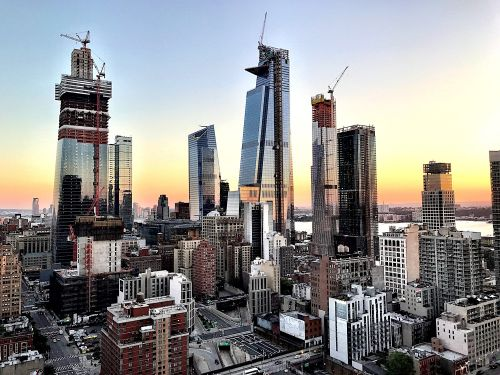Amazon, JPMorgan, and BlackRock are all snapping up space in the new $25 billion Manhattan neighborhood that's reshaping the city