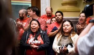 As more cities push for paid sick leave, states push back
