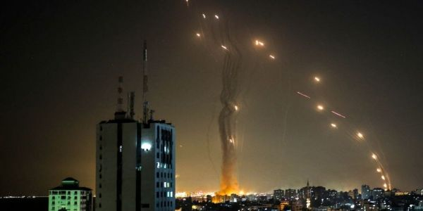 Video shows Iron Dome interceptors filling the sky as more than 100 rockets rain down on Israel