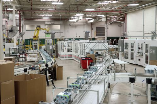 At this Milwaukee factory, orders for hospital wipes are up-as are daily temperature checks