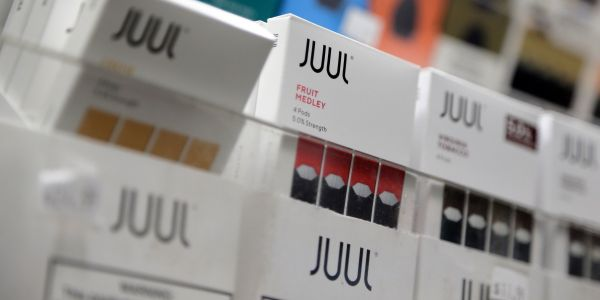 Juul halts US sales of its fruity-flavored vaping pods as regulators investigate it for marketing to minors - just hours after Philip Morris said its rival product targets adults