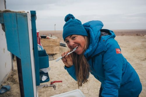 A 48-year-old CEO set out to run 100 marathons in 100 days. Photos show her heart-wrenching journey around the world