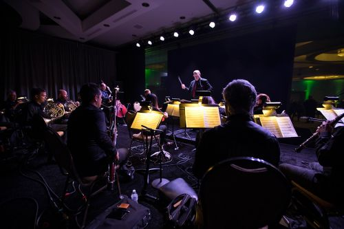 NVIDIA CEO Brings Orchestra, AI-Generated Star Wars Music - and First TITAN V GPUs - to Top AI Brainiacs