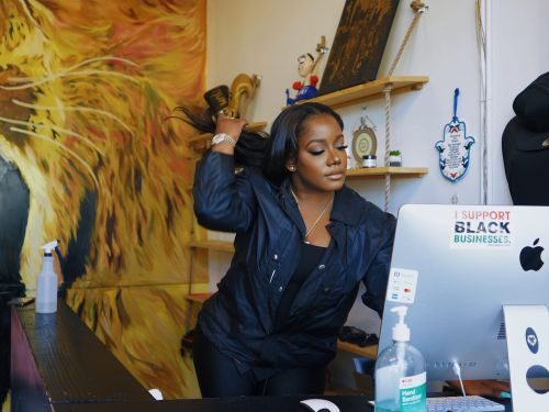 28-year-old Tyra Myricks makes 7-figures and has 5 side hustles. Here's how she typically spends a day